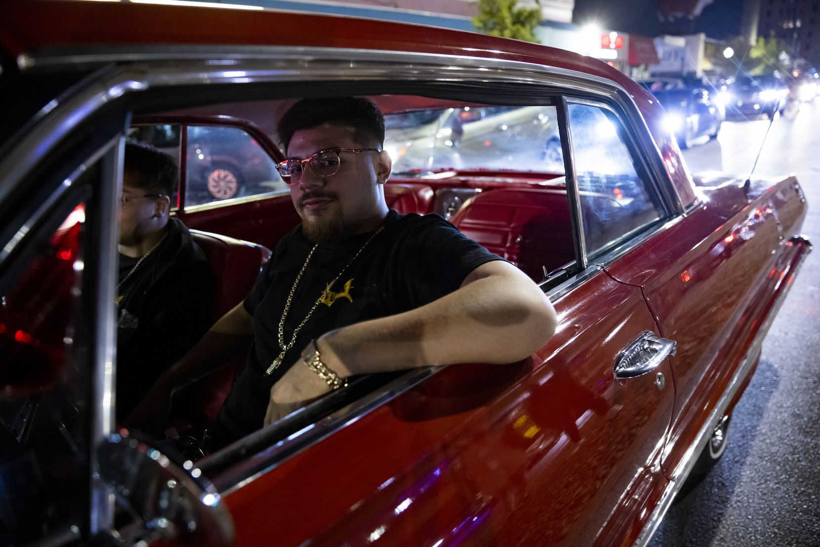 Juan Ortiz cruises in his 1963 Chevrolet Impala Super Sport on Sunday, Sept. 19, 2021, on Jefferson Boulevard in Dallas.