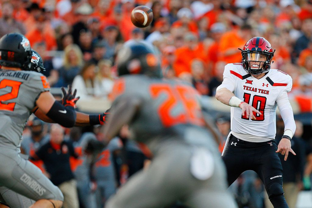STILLWATER, OK - SEPTEMBER 22:  Quarterback Alan Bowman #10 of the Texas Tech Red Raiders throws a 20-yard completion to wide receiver Zach Austin #19 against the Oklahoma State Cowboys in the first quarter on September 22, 2018 at Boone Pickens Stadium in Stillwater, Oklahoma.  Texas Tech won 41-17. (Photo by Brian Bahr/Getty Images)