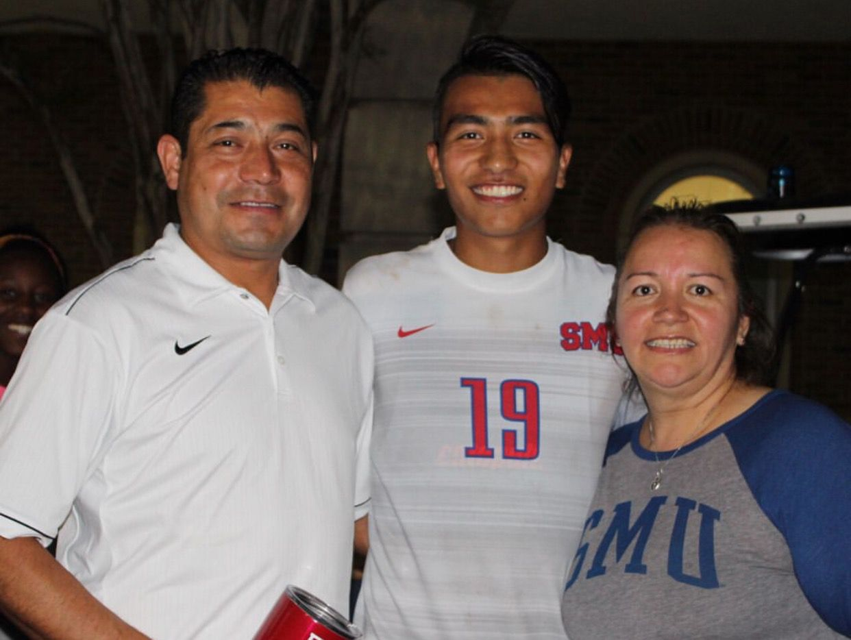 Nicky Hernandez (center) with his parents at an SMU soccer game. Hernandez will be playing for FC Dallas after being taken in the first round of the MLS Superdraft.