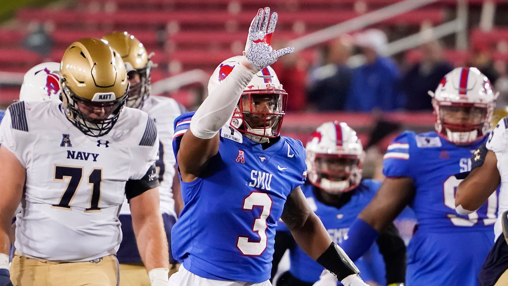 SMU linebacker Delano Robinson (3) celebrates after sacking Navy quarterback Dalen Morris (8) during the third quarter of a game at Ford Stadium on Saturday, Oct. 31, 2020, in Dallas.