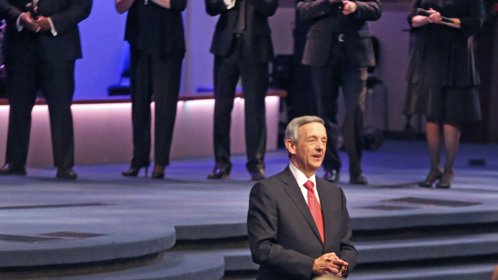 First Baptist Dallas pastor Dr. Robert Jeffress greets the crowd during the 150th anniversary service at First Baptist Church of Dallas Sunday, July 29, 2018. (Louis DeLuca/The Dallas Morning News)