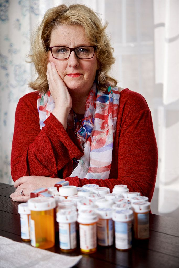 Patti Swearingen of Rowlett with over 30 prescriptions she has taken for a bladder infection she has had for more than five years. She is seeking an experimental treatment called phage therapy in Tbilisi, Georgia.