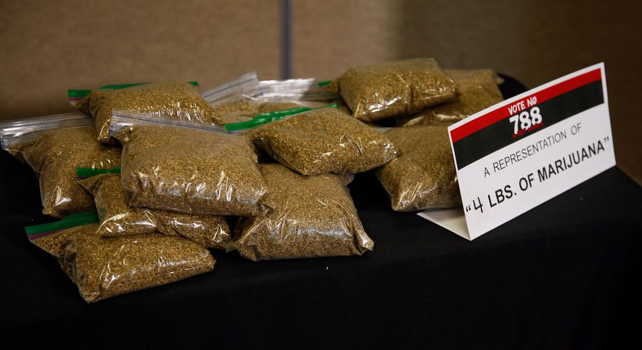 Bags of oregano sit on a table as a representation of what four pounds of marijuana would look like, the amount that would be allowed under SQ788, during a news conference against SQ788 in Oklahoma City, Wednesday, June 20, 2018. Oklahoma's State Question 788, the result of an activist-led signature drive, would allow physicians to approve medical marijuana licenses for people to legally grow, keep and use cannabis. An opposition group that includes law enforcement, business, political and faith leaders is launching a late campaign to defeat it, saying it's too loosely written. (AP Photo/Sue Ogrocki)
