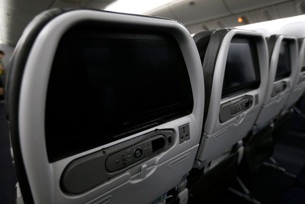 Small monitors are seen on the back of each seats in the cabin area of an American Airlines Boeing 777 jet at the American Airlines Hangar 5 at Dallas/Fort Worth International Airport in DFW Airport, Texas, Friday, Aug. 18, 2017. (Jae S. Lee/The Dallas Morning News)