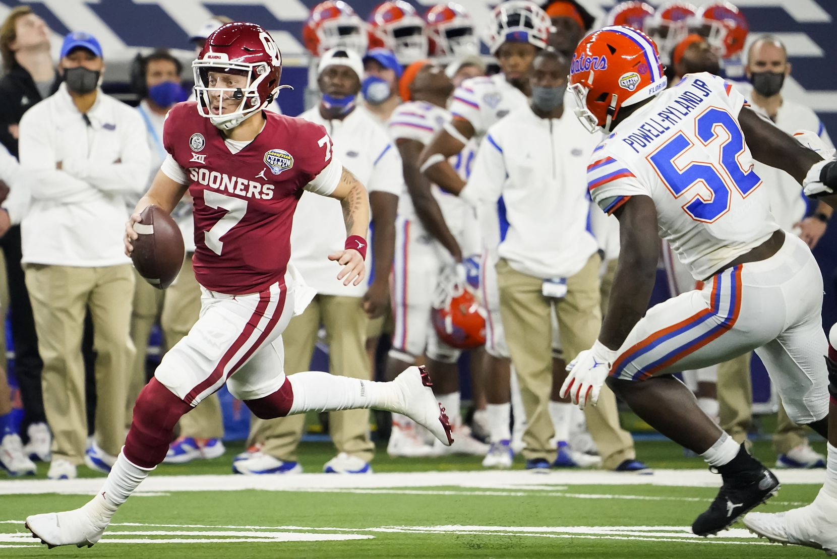 Oklahoma quarterback Spencer Rattler (7) scrambles for a first down past Florida linebacker Antwuan Powell-Ryland Jr. (52) during the second half of the Cotton Bowl Classic at AT&T Stadium on Wednesday, Dec. 30, 2020, in Arlington. (Smiley N. Pool/The Dallas Morning News)