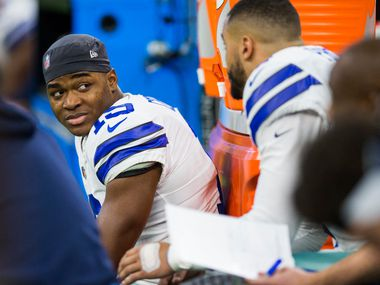 Dallas Cowboys wide receiver Amari Cooper (19) talks with quarterback Dak Prescott (4) on the bench during the fourth quarter of an NFL game between the Dallas Cowboys and the Indianapolis Colts on Sunday, December 16, 2018 at Lucas Oil Stadium in Indianapolis, Indiana.
