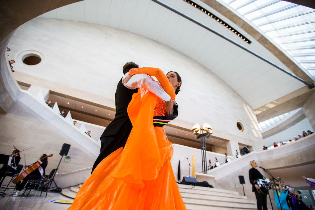 """Dillon Weir and Stejara Dinulescu of the SMU ballroom dance team perform with musician Sarah Jaffe during a pop-up performance titled """"Eyes as Bright as Diamonds"""" to kick off the Soluna International Music & Arts Festival on April 11."""