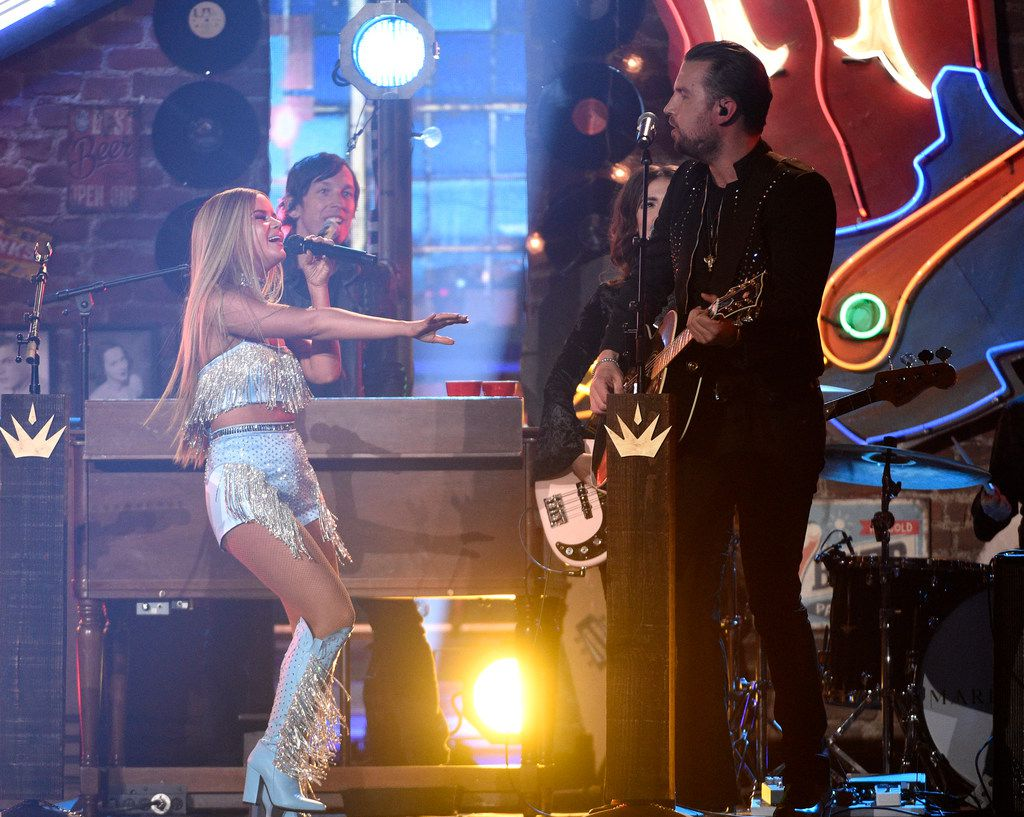 """T.J. Osborne, of Brothers Osborne, right, and Maren Morris perform """"All My Favorite People"""" at the 54th annual Academy of Country Music Awards at the MGM Grand Garden Arena on Sunday, April 7, 2019, in Las Vegas. (Photo by Chris Pizzello/Invision/AP)"""