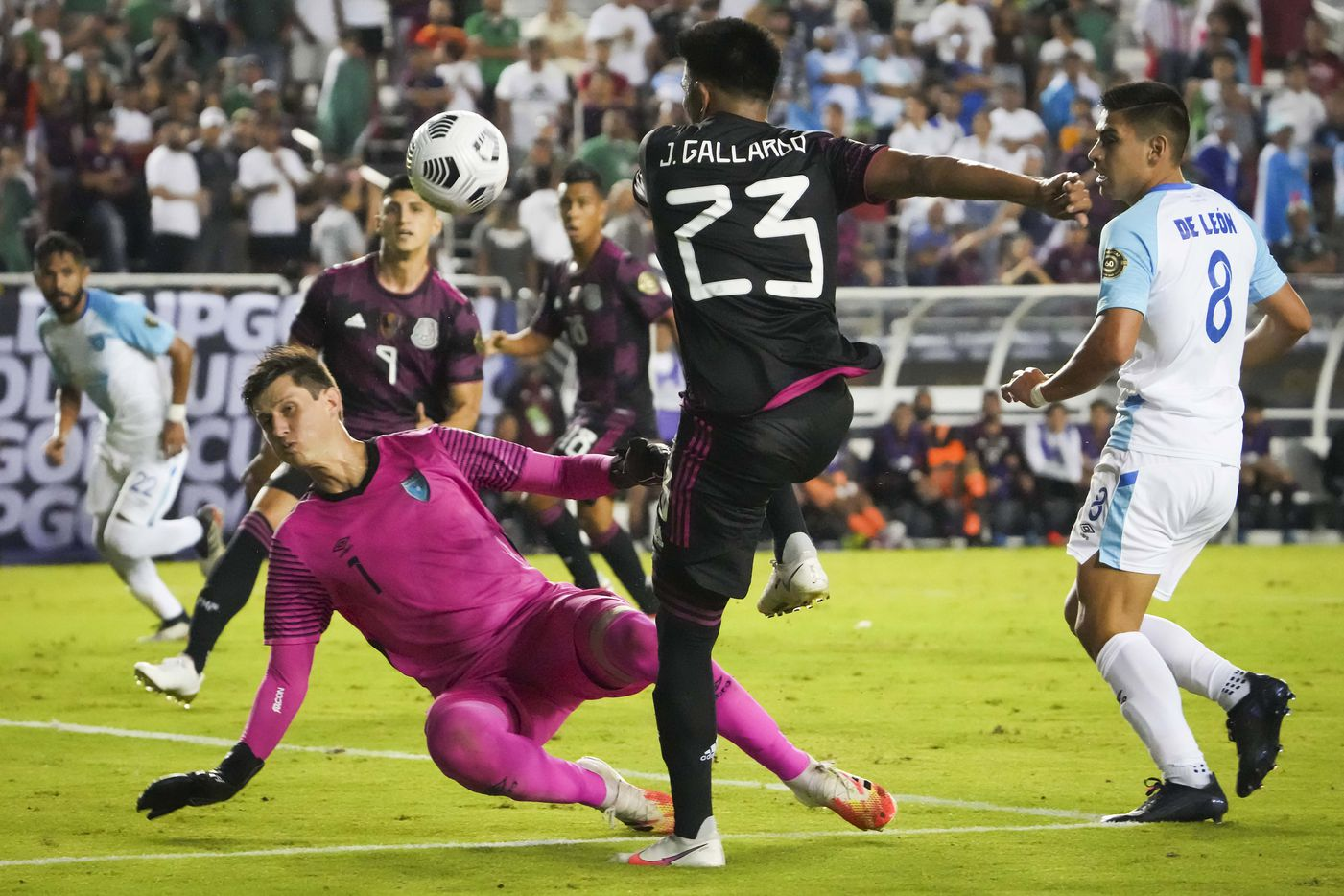 Guatemala goalkeeper Nicholas Hagen (1) makes a save against Mexico midfielder Jesús Gallardo (23) during the second half of a CONCACAF Gold Cup Group A soccer match at the Cotton Bowl on Wednesday, July 14, 2021, in Dallas.