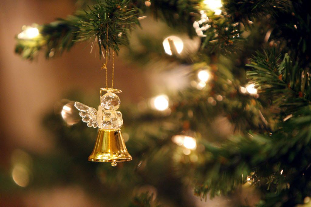 """A glass angel ornament hangs from the """"Tree of Angels"""" at Cliff Temple Baptist Church"""
