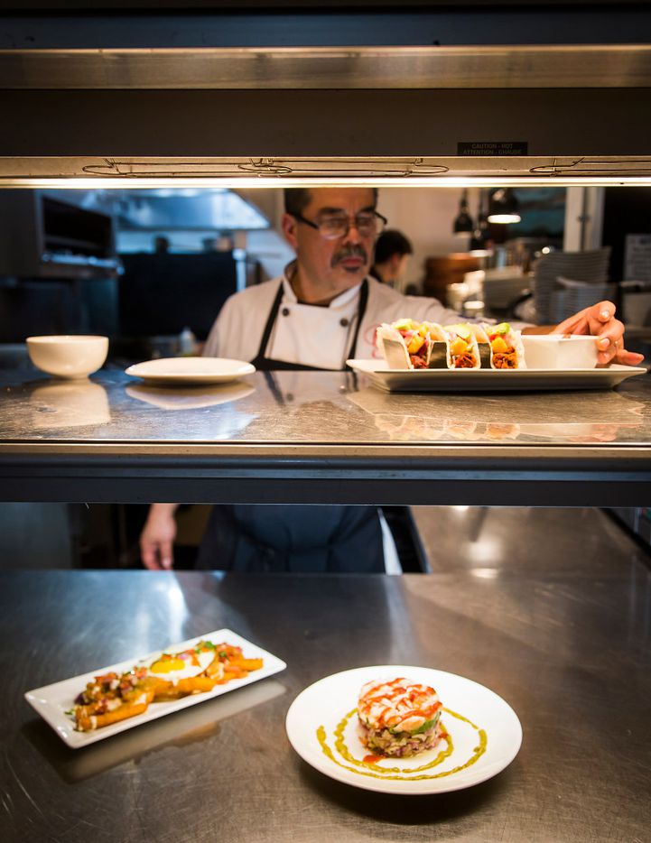 Chef Beto Rodarte puts the finishing touches on a plate ready awaiting pickup in the in the kitchen at Beto and Son restaurant in Trinity Groves.