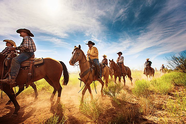 Waggoner Cowboys ride out into the pasture to round up cattle. The Waggoner Ranch, located in North Texas, is the largest ranch under one fence in the United States spreading 510,00 acres into six counties. Photographer Jeremy Enlow documented the 26 cowboys who work on the ranch and published a 140 page coffee table hardcover book, Cowboys of the Waggoner Ranch, which was released Nov. 1, 2015.