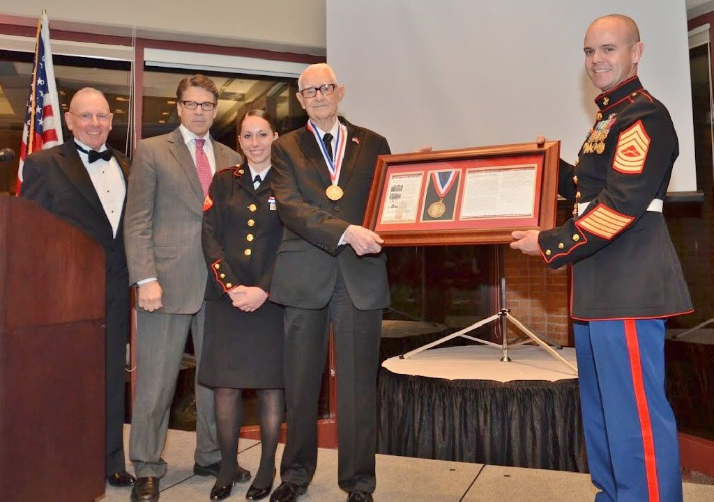 Master Sgt. Gene Overstreet (right), former Texas Gov. Rick Perry, Lance Cpl. Alexandria Megelich and Master Sgt. John Collins honored author and veteran Sgt. R.V. Burgin (second from right) in 2014 for his service during World War II.