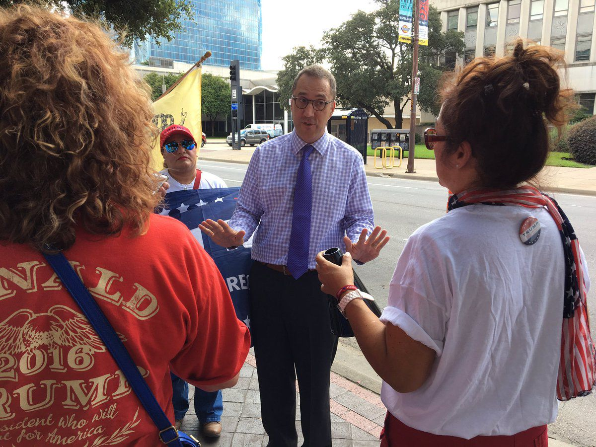 Dallas Morning News editor Mike Wilson speaks with pro-Trump protesters outside the newspaper.