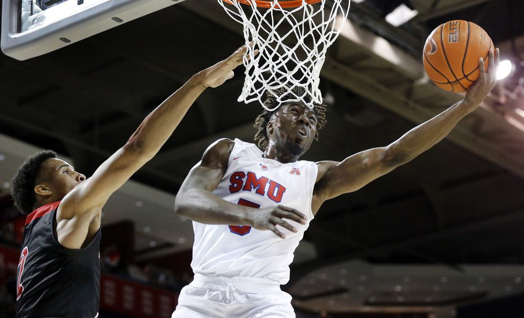 Southern Methodist Mustangs guard Emmanuel Bandoumel (5) lays up a shot against Jacksonville State Gamecocks forward Jacara Cross (2) during the first half at Moody Coliseum  in University Park, Texas, Tuesday, November 5, 2019. (Tom Fox/The Dallas Morning News)