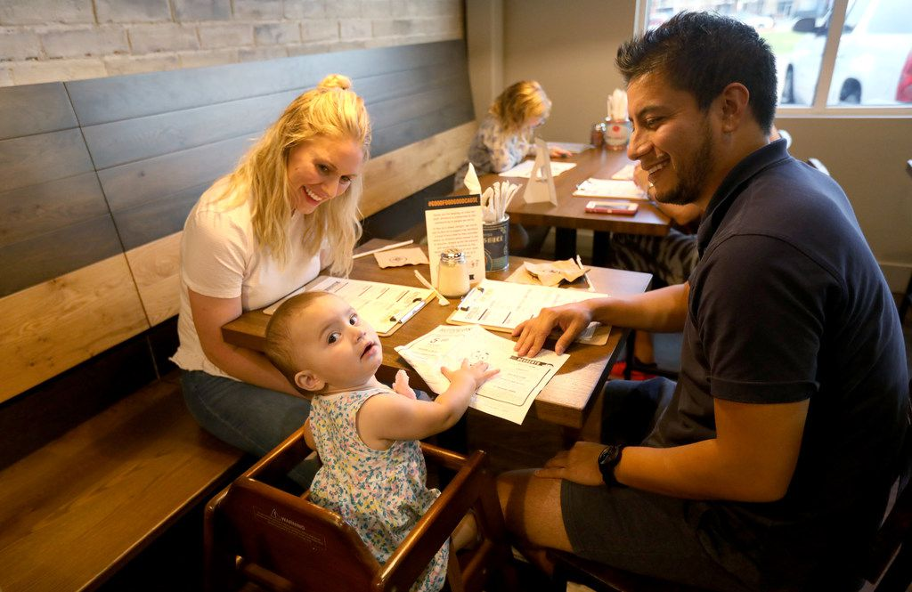 Blair Vanschuyver, Gerry Alcantara with daughter Kennedy, 1, during the 'friends and family' dinner at the new restaurant, Rotolo's Craft & Crust, in Frisco, Texas Saturday, Sept. 29, 2018. (Anja Schlein/Special Contributor)