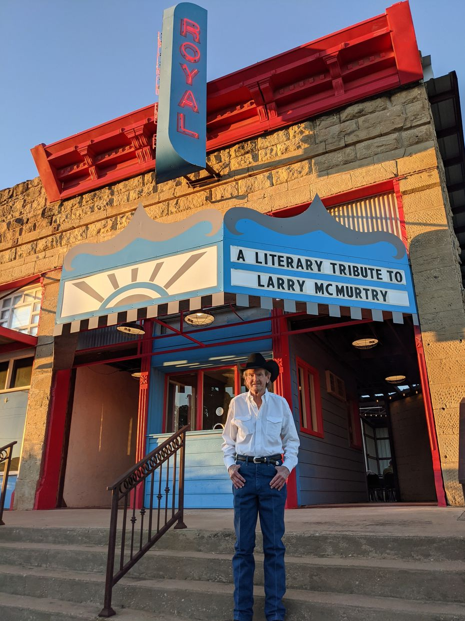 Charlie McMurtry, 72, the younger brother of author Larry McMurtry, stands under the marquee of the Royal Theater in Archer City on Saturday, Oct. 9, 2021. Charlie, who's 13 years younger than Larry, was attending the literary tribute to his brother, who died in March 2021.