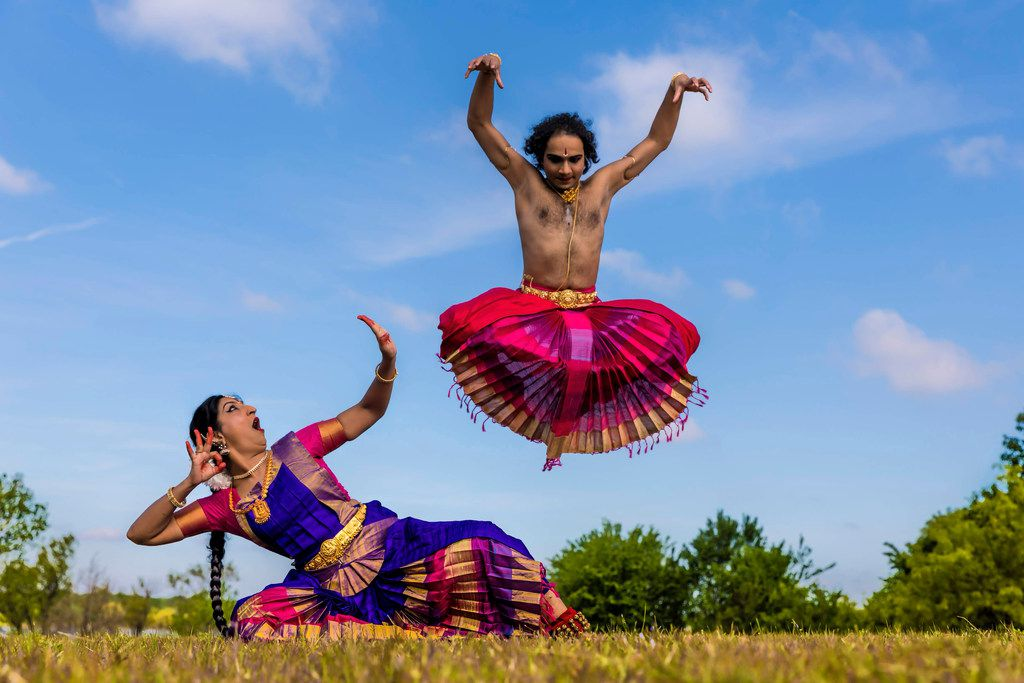 Chintan Patel leaps above Tejas Dance founder and director Bhuvana Venkatraman in the Bharatanatyam style of Indian classical dance.  (Photo by Memoirs Photography)