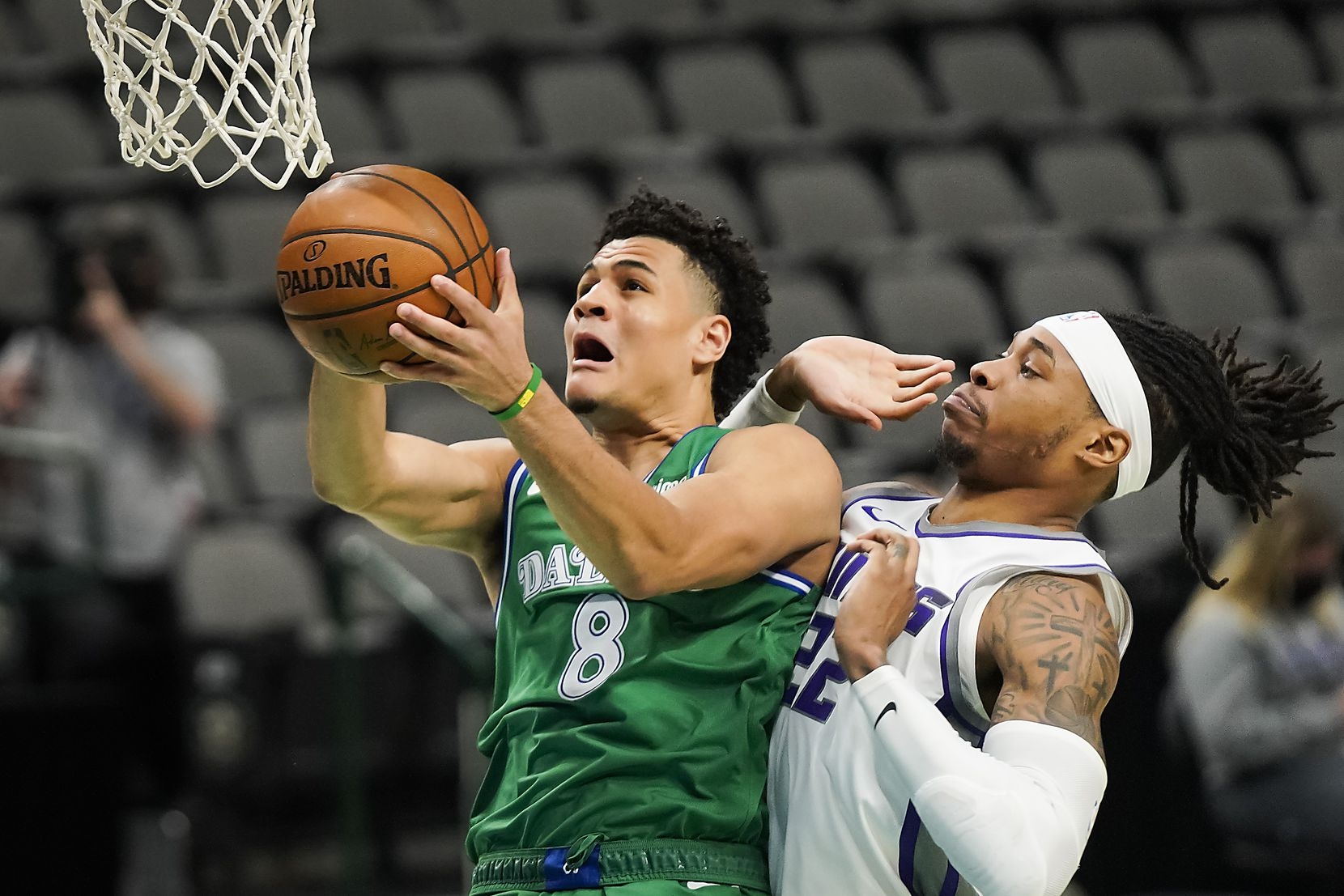 Dallas Mavericks guard Josh Green (8) drives to the basket past Sacramento Kings center Richaun Holmes (22) during the first half of an NBA basketball game at American Airlines Center on Sunday, May 2, 2021, in Dallas.