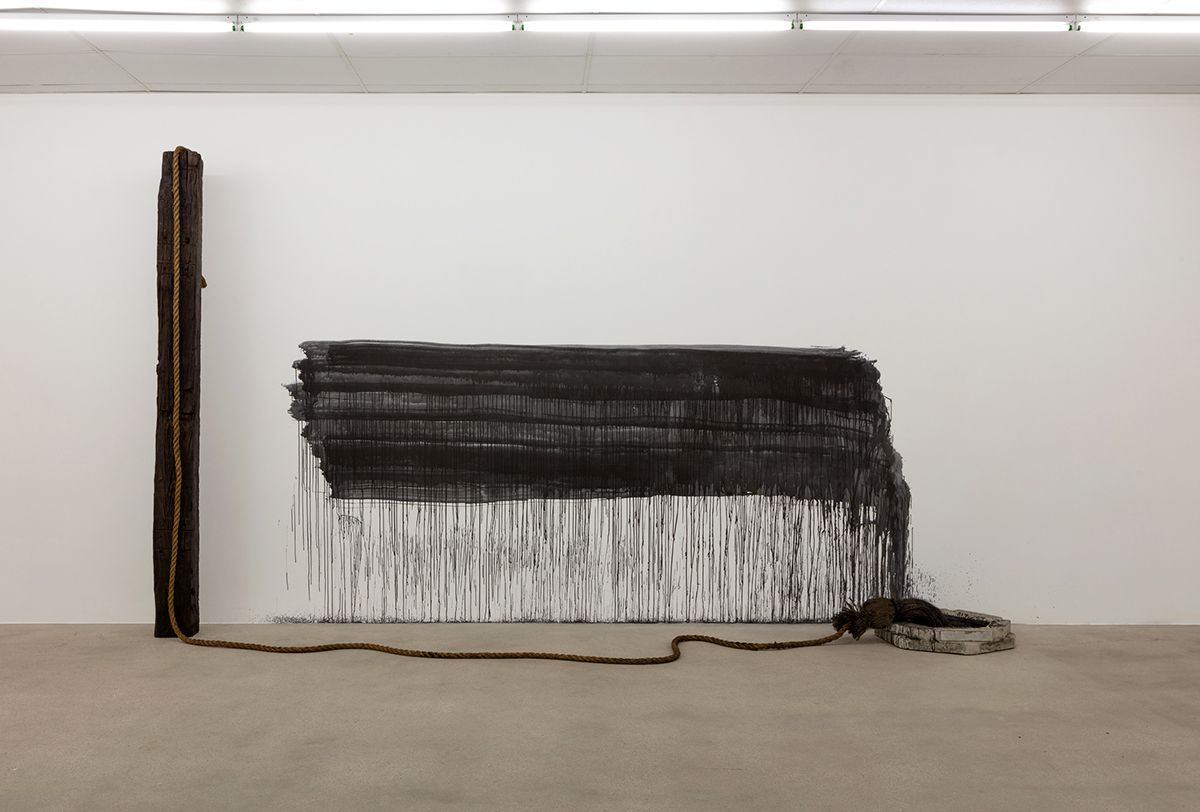 """""""Untitled (brush, railroad tie, rope, charcoal, concrete, ink)"""" is among Oshay Green's works on display at the And Now gallery through May 30."""