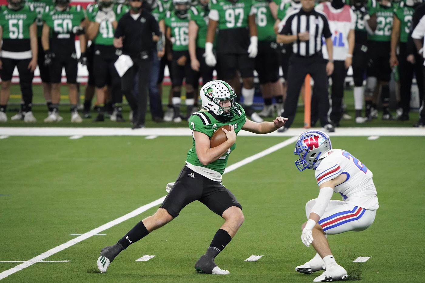 Southlake Carroll quarterback Quinn Ewers (3) tries to get past Austin Westlake defensive back Patrick Churchill (24) during the second quarter of the Class 6A Division I state football championship game at AT&T Stadium on Saturday, Jan. 16, 2021, in Arlington, Texas.