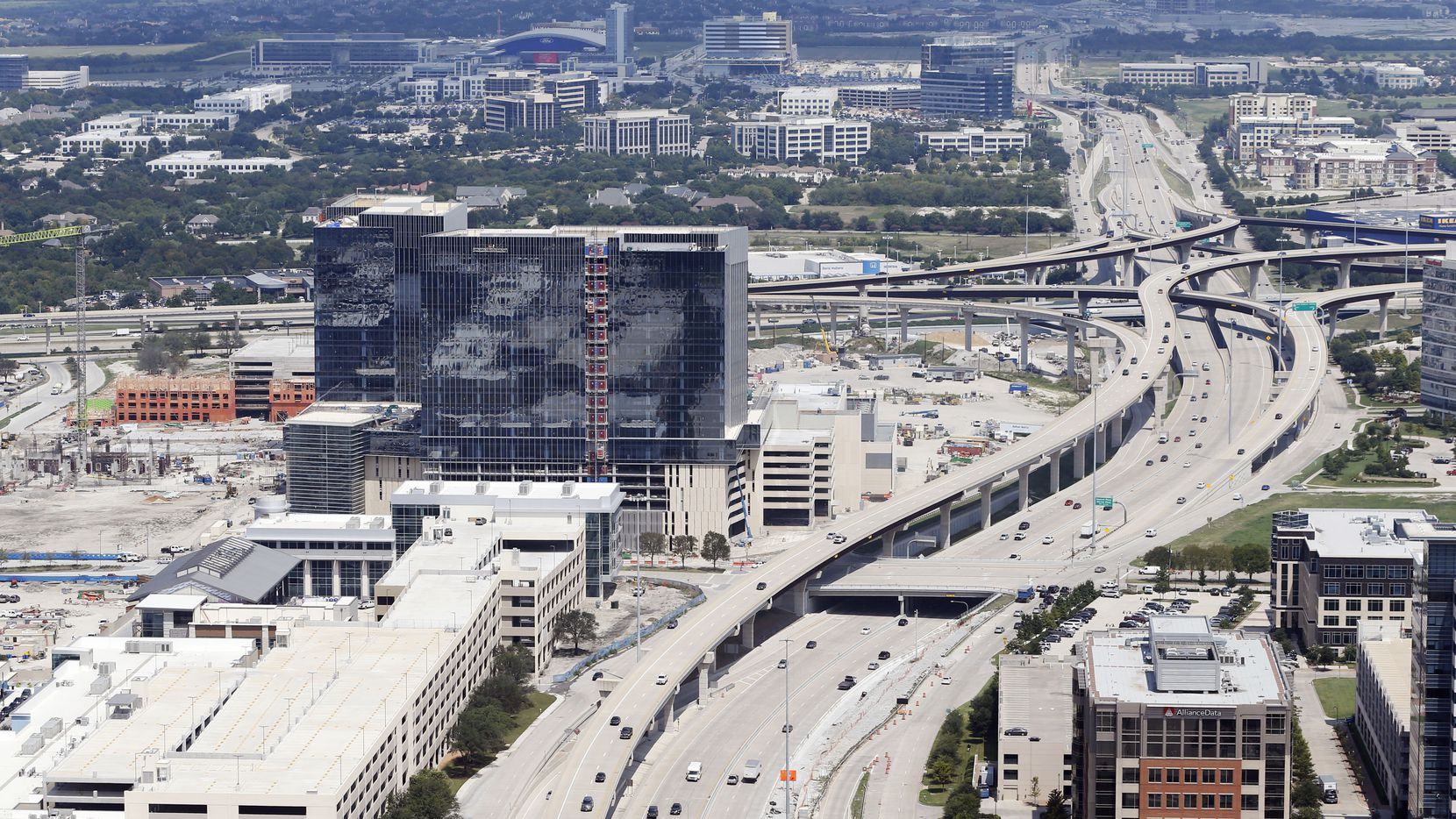 Dallas North Tollway splits Legacy West (left) and Shops of Legacy (right) in Plano, Texas on Thursday, August 31, 2017.