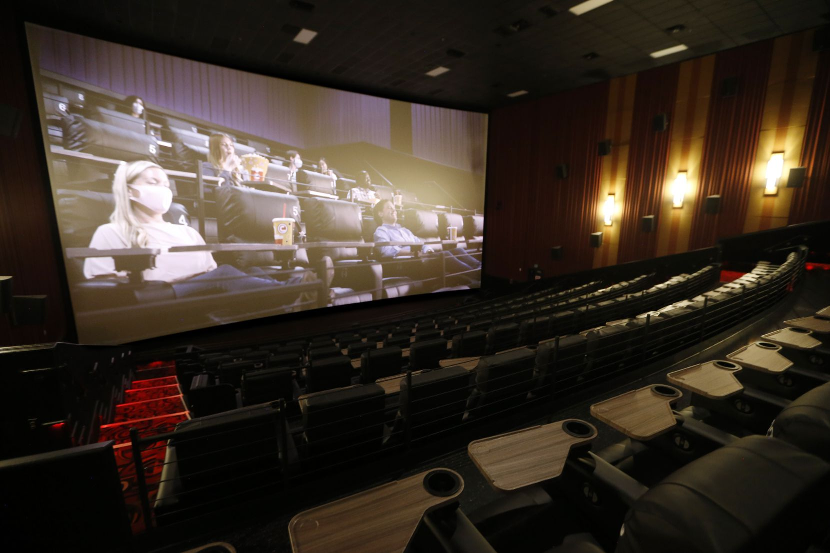 A Cinemark video plays about the safety measures that are in place at Cinemark West in Plano. The theater will clean seats and handrails after each showing.