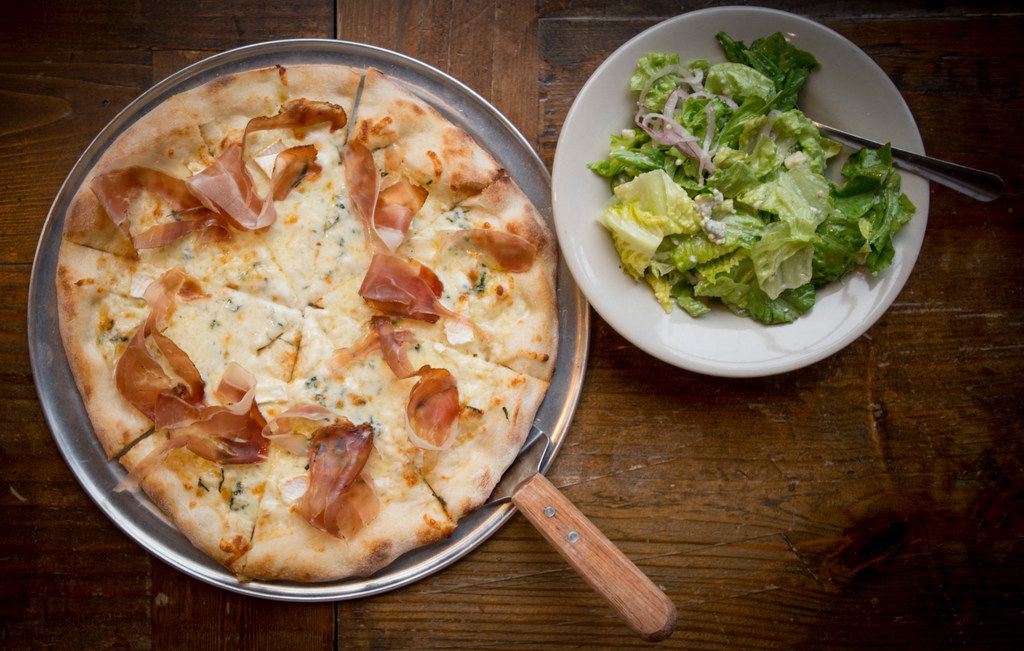 Menu items at Fort Brewery and Pizza include the speck and mozzarella pizza and salad.