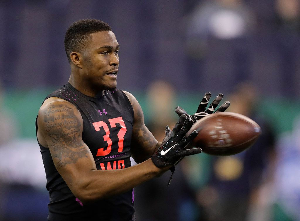 Florida State wide receiver Auden Tate runs a drill during the NFL football scouting combine, Saturday, March 3, 2018, in Indianapolis. (AP Photo/Darron Cummings)