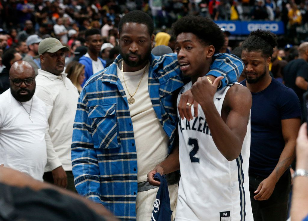 Dwyane Wade walks off the court with his son Zaire Wade after Sierra Canyon defeated Duncanville during their high school boys basketball game during the Thanksgiving Hoopfest in Dallas, Tx, Saturday, Nov. 30, 2019. (Michael Ainsworth)