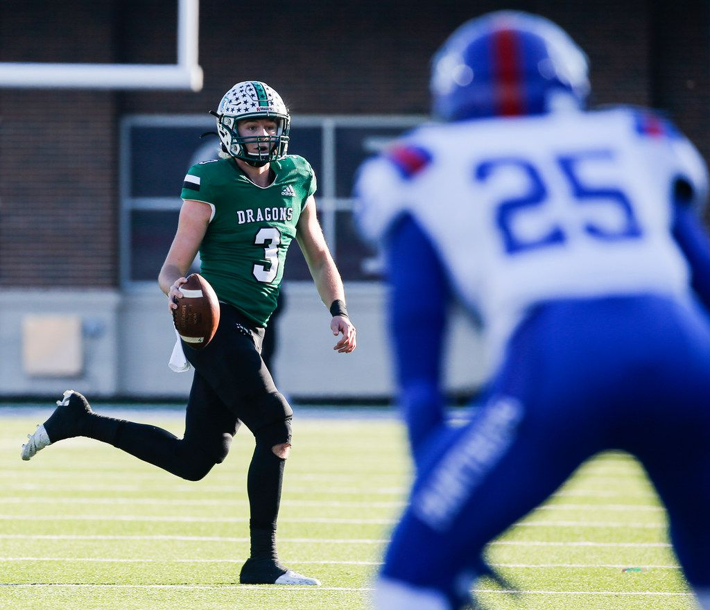 Southlake Carroll quarterback Quinn Ewers (3) looks for a receiver as Duncanville defensive back Thailan Scott (25) defends during the first half of a Class 6A Division I Region I high school football matchup between Southlake Carroll and Duncanville on Saturday, Dec. 7, 2019 at McKinney ISD Stadium in McKinney, Texas. (Ryan Michalesko/The Dallas Morning News)