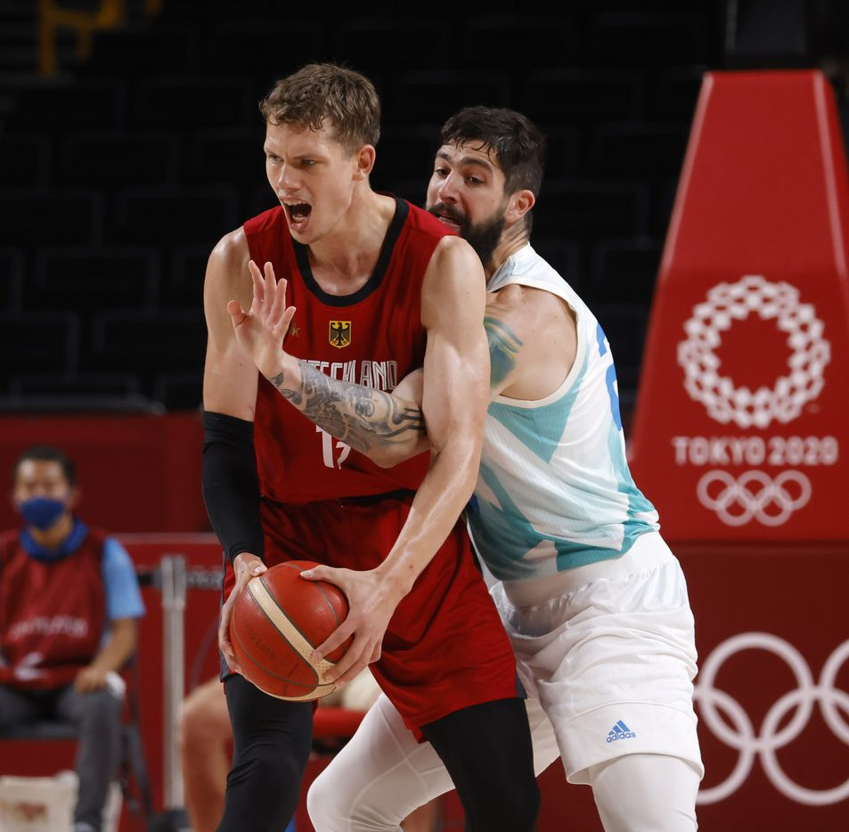 Slovenia's Ziga Dice (27) defends as Germany's Moritz Wagner (13) looks to pass during the first half of play of a quarter final basketball game at the postponed 2020 Tokyo Olympics at Saitama Super Arena, on Tuesday, August 3, 2021, in Saitama, Japan. (Vernon Bryant/The Dallas Morning News)