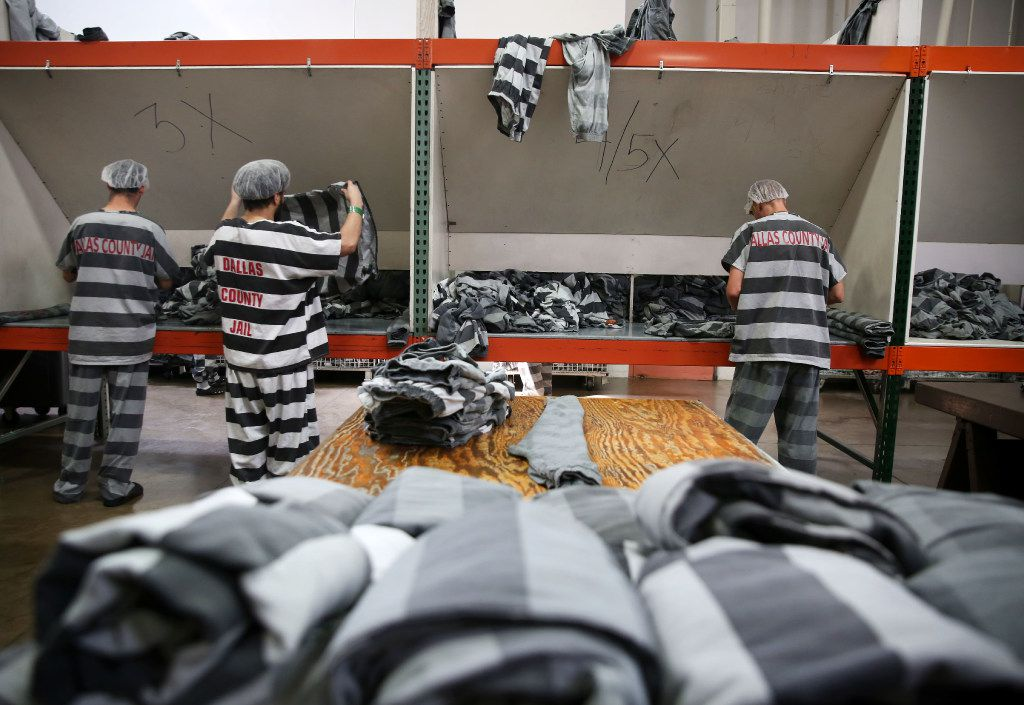 Inmates fold freshly laundered uniforms at the Cook-Chill facility.