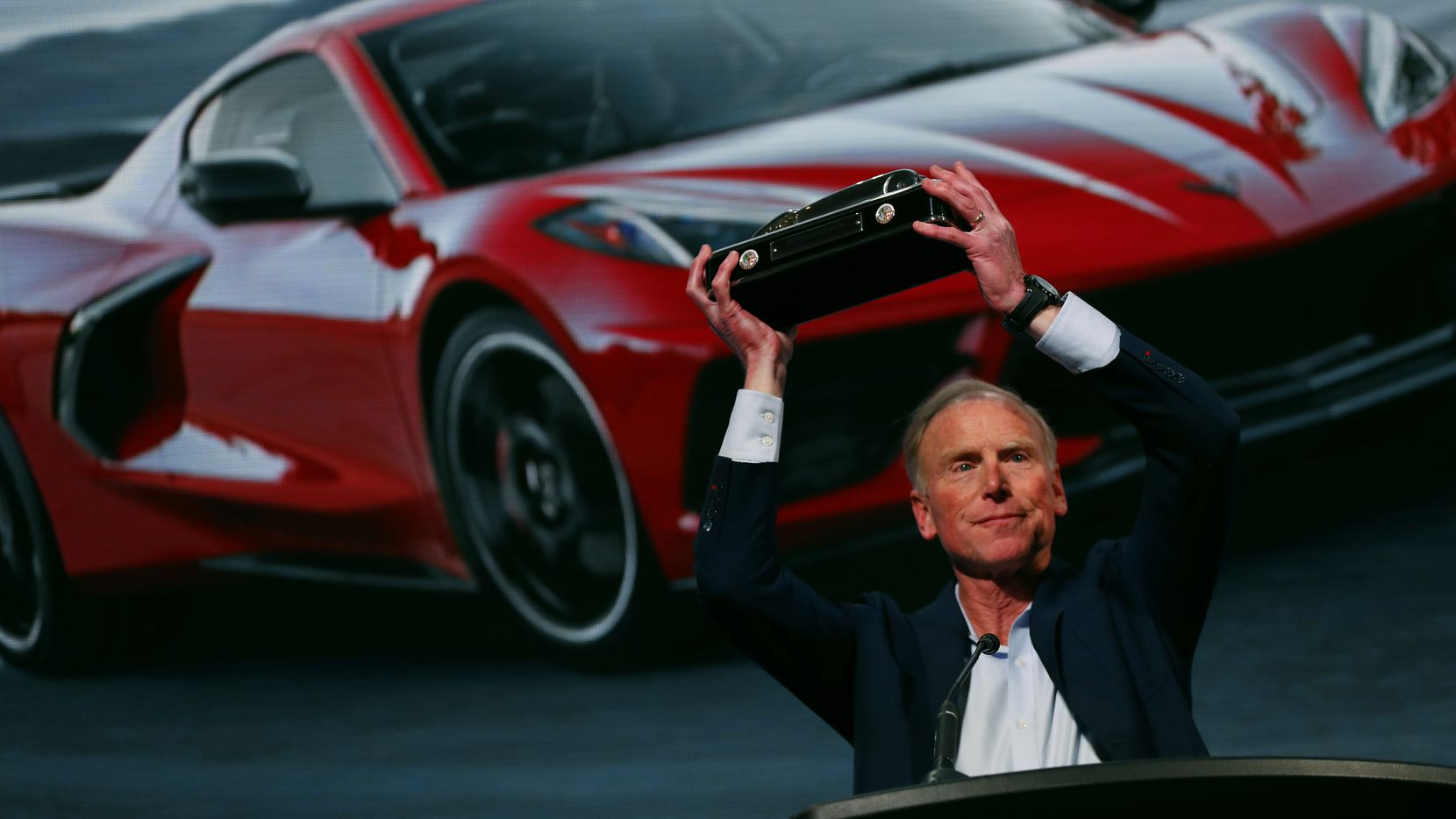 Tadge Juechter, Corvette executive chief engineer, holds up the trophy after the new mid-engine Chevrolet Corvette was named the North American Car of the Year in Detroit on Monday. (AP Photo/Paul Sancya)
