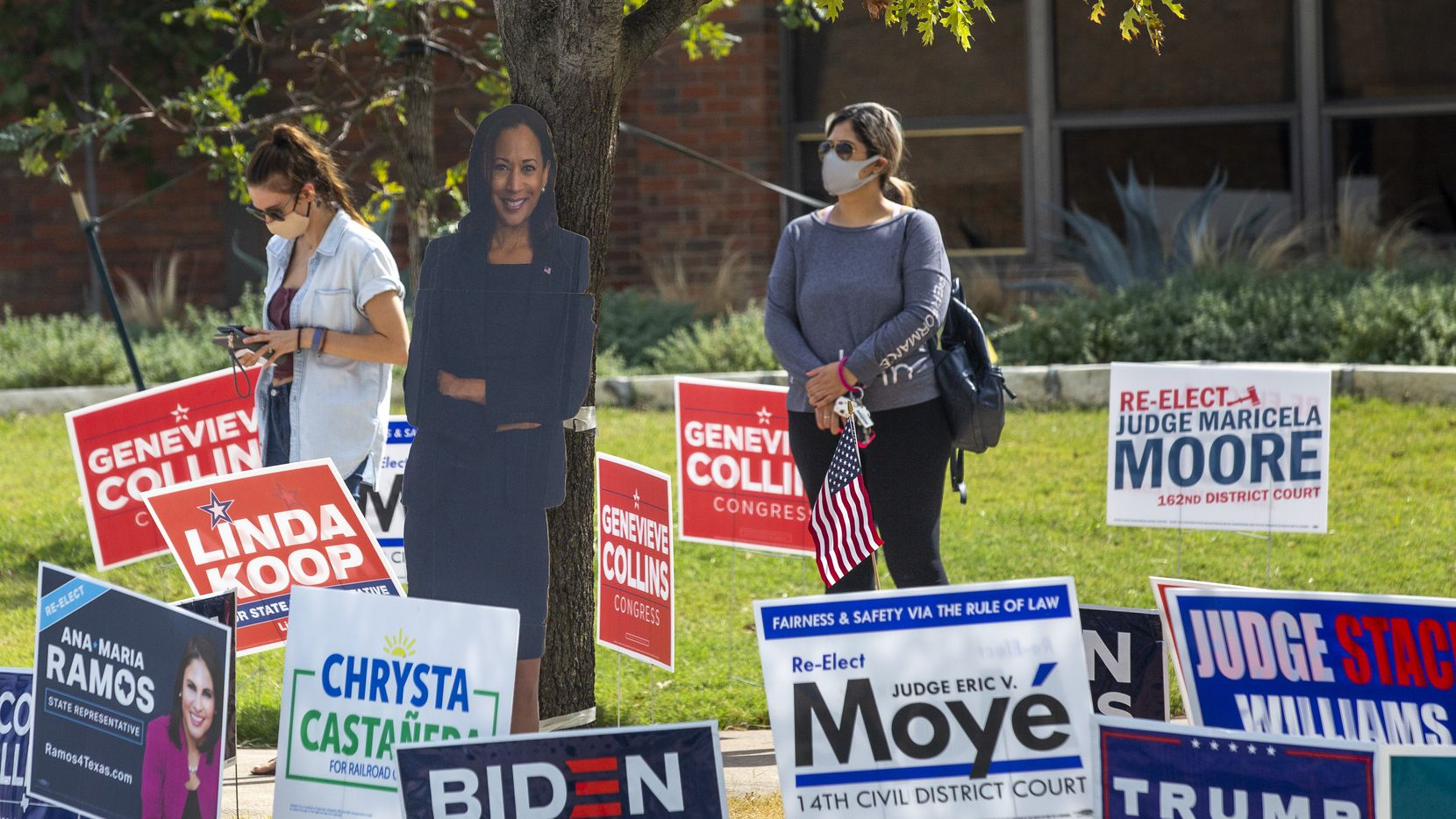 Voters line up to cast their ballot during the early voting period for the general U.S. election at Fretz Park Public Library in Dallas on Tuesday, Oct. 20, 2020. The FBI and local elections officials say early voting is far uneventful, but authorities are preparing for the worst on Election Day.