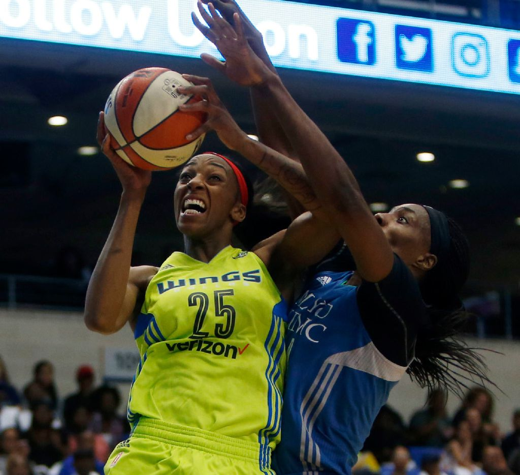 Dallas Wings forward Glory Johnson (25) lays up a shot against Minnesota Lynx center Sylvia Fowles (34) in the first quarter at College Park Center in Arlington, Texas on Saturday, May 20, 2017. (Rose Baca/The Dallas Morning News)