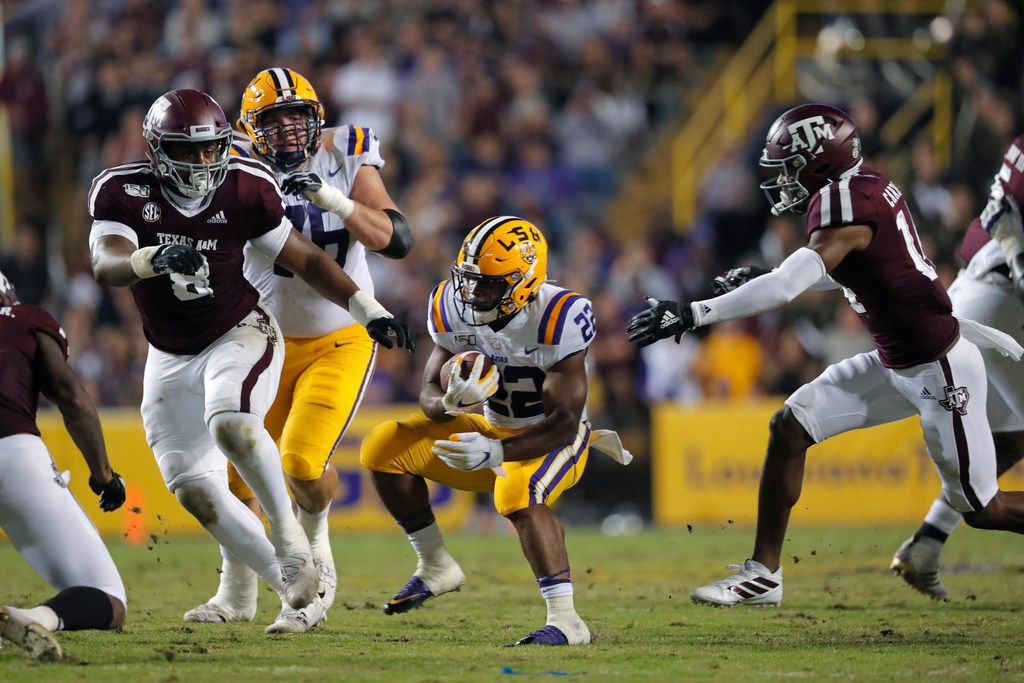LSU running back Clyde Edwards-Helaire (22) carries in the first half of an NCAA college football game against Texas A&M in Baton Rouge, La., Saturday, Nov. 30, 2019. (AP Photo/Gerald Herbert)