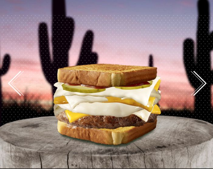 My Texas burger standing proudly in front of a field of Texas saguaros.