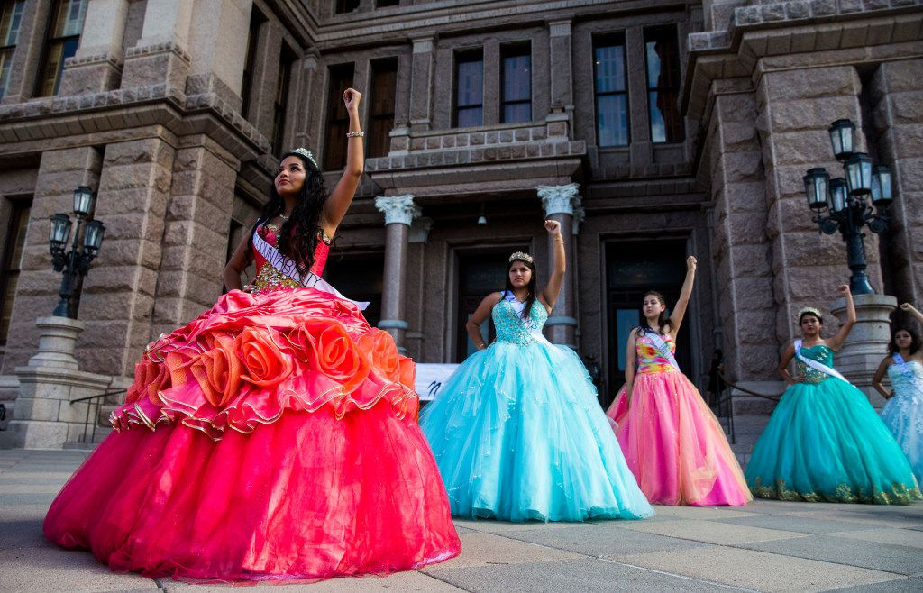 Teenage girls with Jolt Texas hold symbolic quinceañeras to protest the sanctuary cities ban on Wednesday outside the Texas Capitol in Austin.