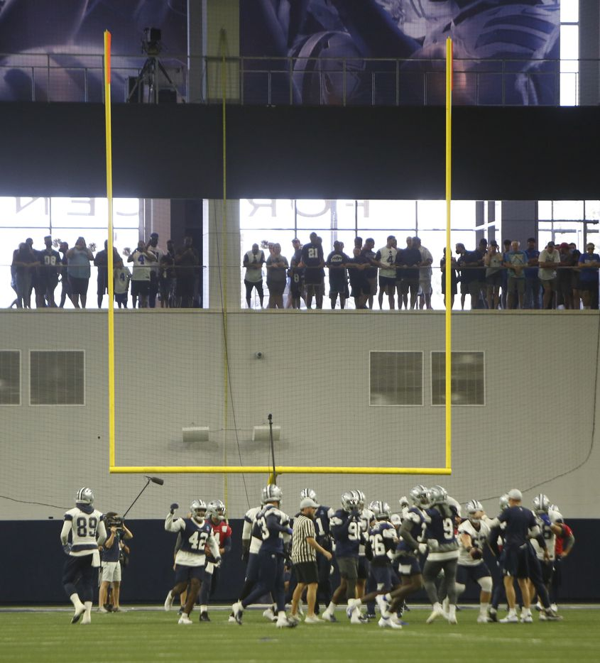 Dallas Cowboys fans oversee a team practice session from the foyer of the Ford Center. The Cowboys conducted their final public football practice session inside The Star at the Ford Center in Frisco on August 28, 2021. (Steve Hamm/ Special Contributor)