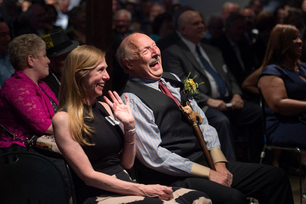Dallas sports talk radio host Norm Hitzges and his wife Mary laugh during Dale Hansen's acceptance speech at the Press Club of Dallas' North Texas Legends Awards ceremony on June 3 at The Sixth Floor Museum in Dallas.  Hitzges and Hansen both received awards.