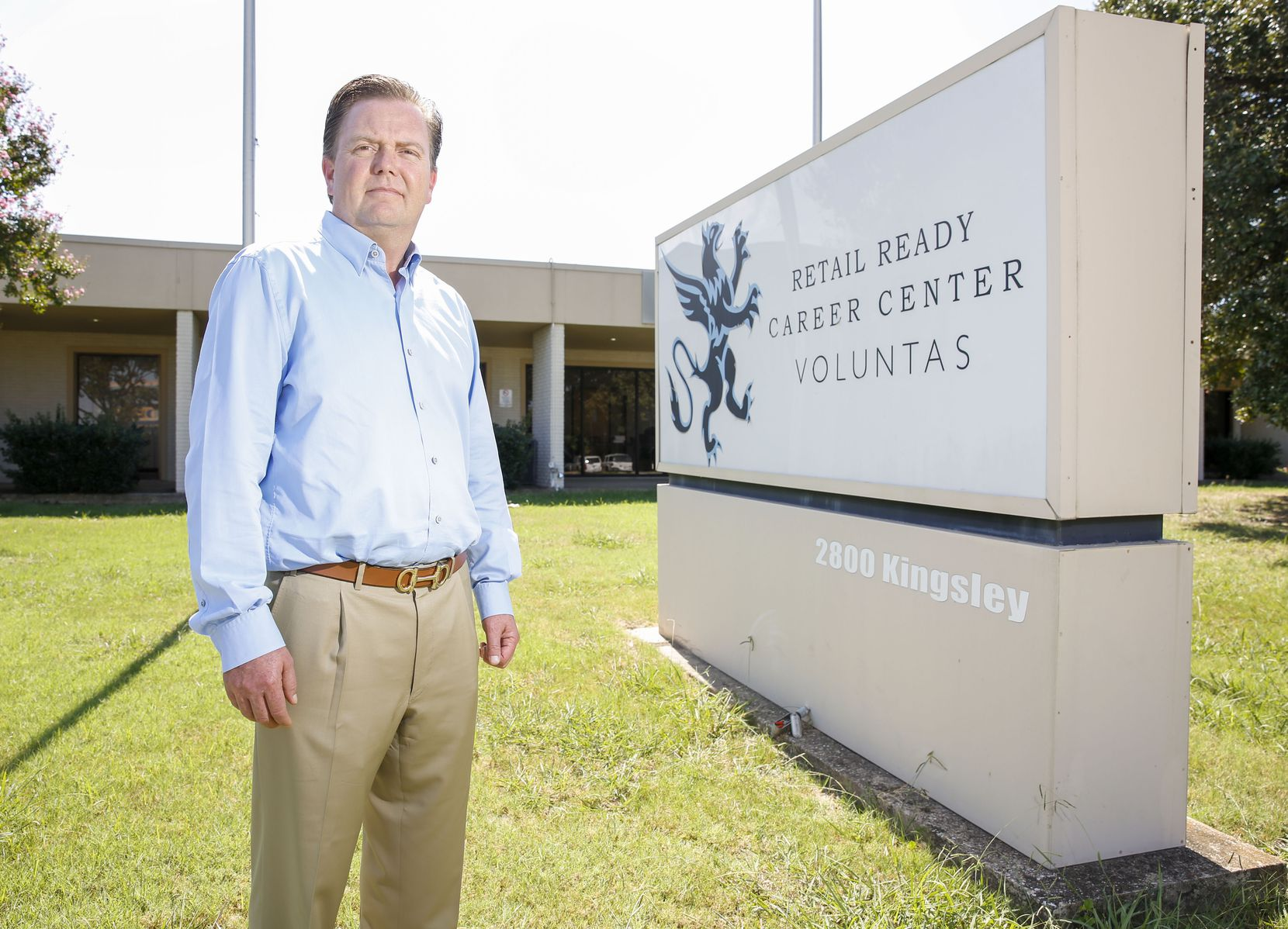 Jonathan Davis, owner of the now-defunct Retail Ready Career Center, stands outside the building that housed his business in Garland in September 2019. He was convicted in federal court of scamming the government's GI Bill out of about $70 million,