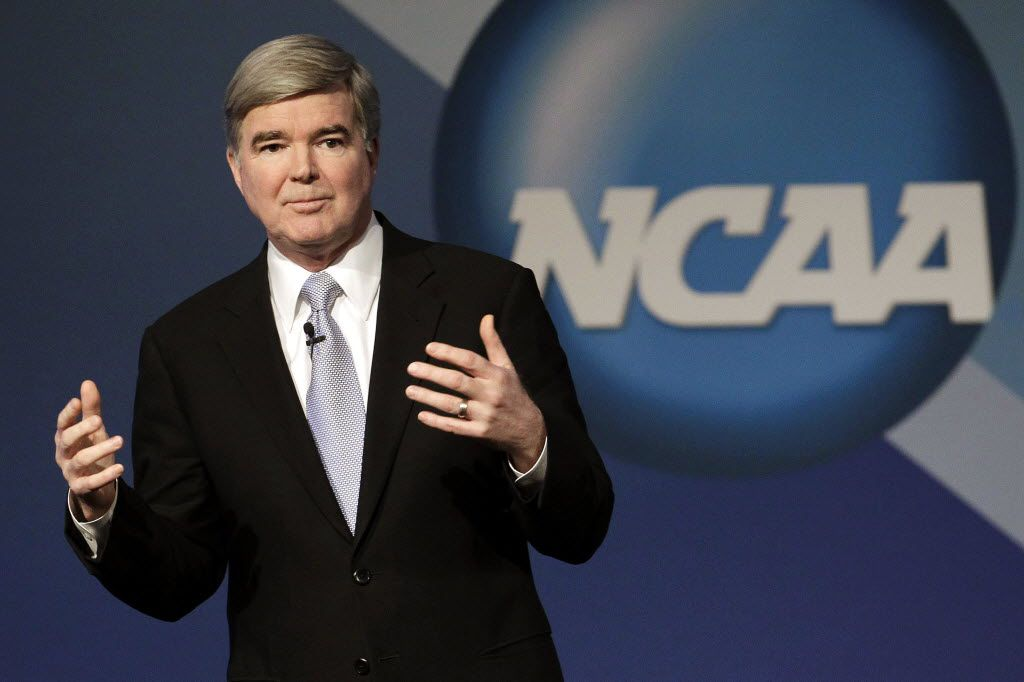 """In this Jan. 12, 2012, file photo, NCAA President Mark Emmert delivers his State of the Association speech during the NCAA's annual convention in Indianapolis. Emmert spoke on a variety of issues during a stop at the Big 12's annual meeting, Thursday, May 31, including his belief that another round of conference realignment could be sparked by schools trying to position themselves to play in a proposed four-team college football playoff, as well as the growing gulf between """"haves"""" and """"have nots,"""" the loopholes that exist for student-athletes to transfer and the concussion epidemic in all level of sports."""