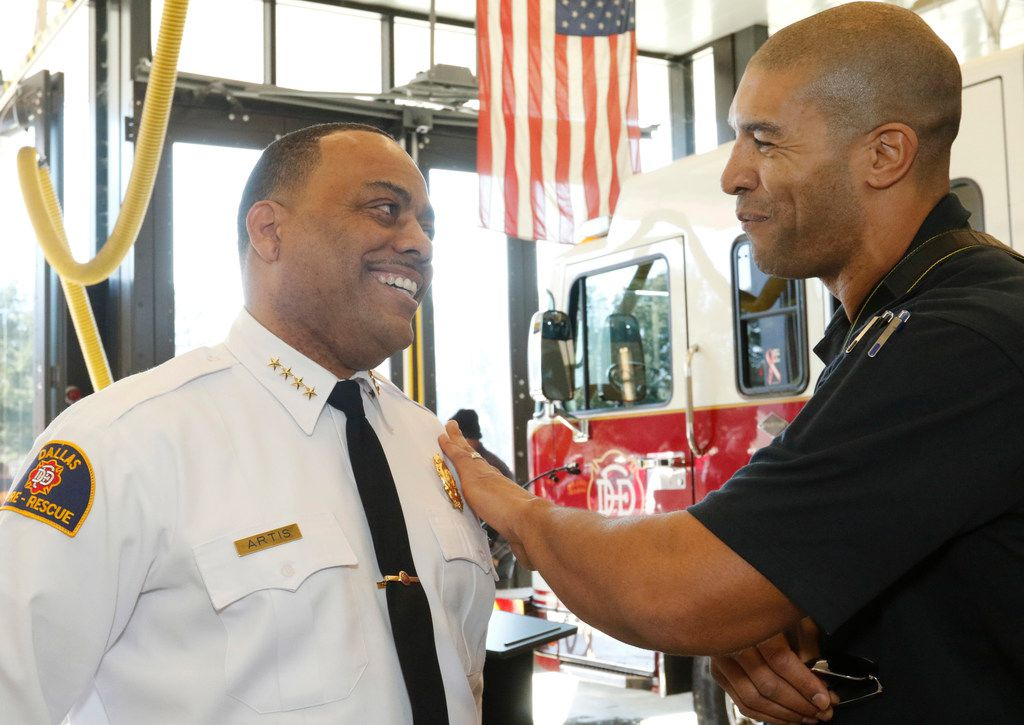 New Dallas Fire-Rescue Chief Dominique Artis talks with Dallas Fire-Rescue spokesman Jason Evans after speaking to the news media Friday.