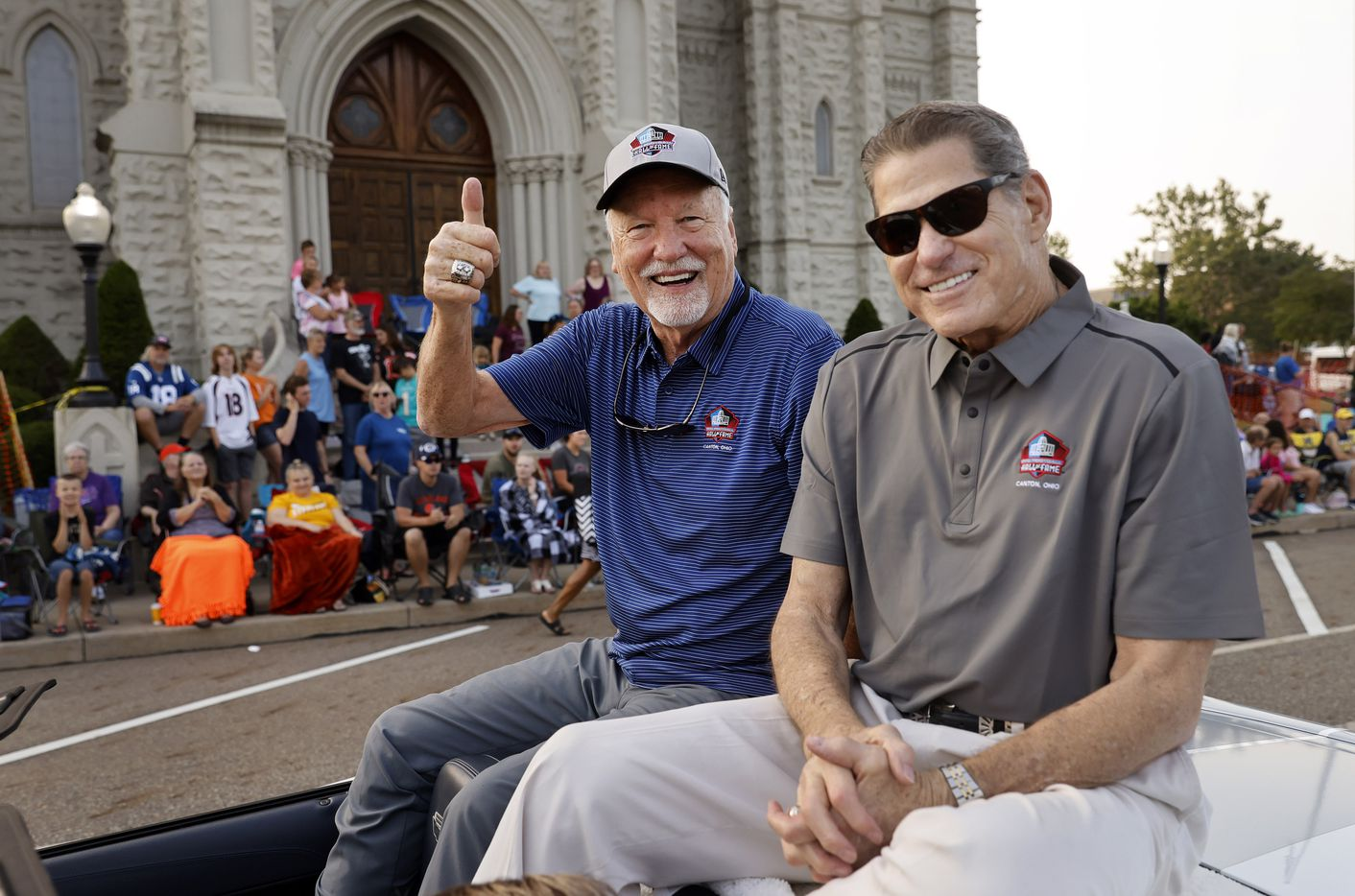 Dallas Cowboys Pro Football Hall of Fame inductee Cliff Harris (left) and former Cowboys safety Charlie Waters pose for a photo along the Canton Repository Grand Parade route in downtown Canton, Ohio, Saturday, August 7, 2021. The parade honored newly elected and former members of the Hall, including newcomers and former Dallas Cowboys players Cliff Harris, Drew Pearson and head coach Jimmy Johnson. (Tom Fox/The Dallas Morning News)