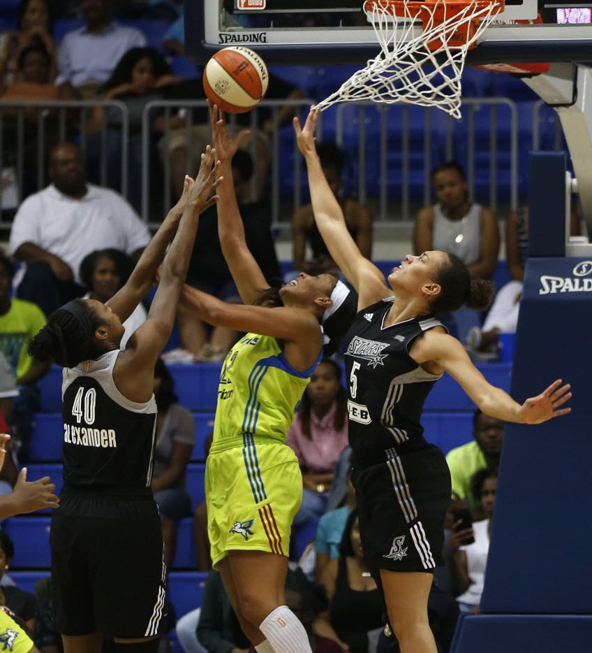 Dallas Wings forward Plenette Pierson (22) lays up a shot for a basket against San Antonio Stars center Kayla Alexander (40) and San Antonio Stars forward Dearica Hamby (5) during the second quarter at College Park Center in Arlington, Texas on Thursday, June 23, 2016. (Rose Baca/The Dallas Morning News)