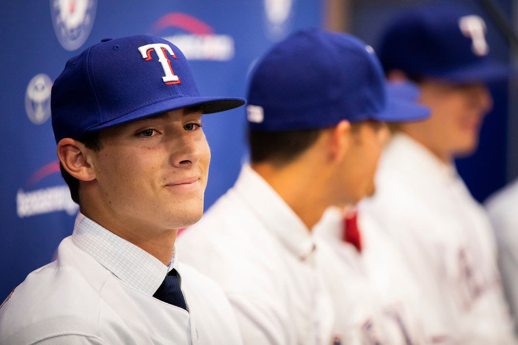 Texas Rangers 1st round pick, pitcher Cole Winn of Orange Lutheran (CA) High School, addresses the media as the Rangers announced the signings of several of the club's draft picks from last week's MLB draft at Globe Life Park on Tuesday, June 12, 2018, in Arlington. (Smiley N. Pool/The Dallas Morning News)