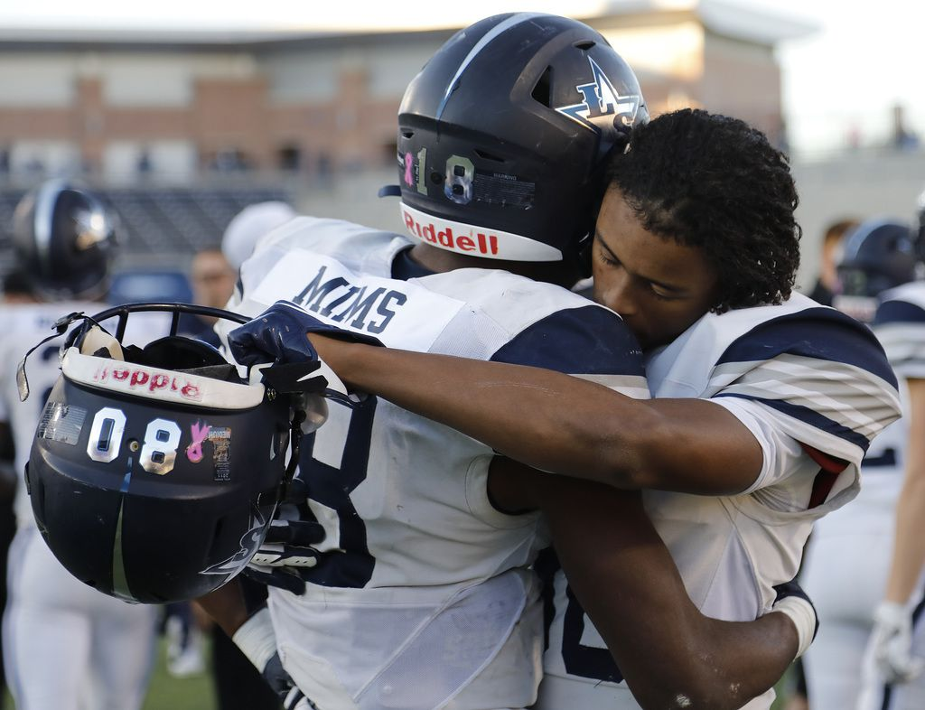 Lone Star High School wide receiver Marvin Mims (18) and Lone Star High School wide receiver Zion Steptoe (80) embrace after their season came to an end 35-7, as Frisco Lone Star High School played Denton Ryan High School in a Class 5A Division I state semifinal game at Eagle Stadium in Allen on Saturday, December 14, 2019. (Stewart F. House/Special Contributor)