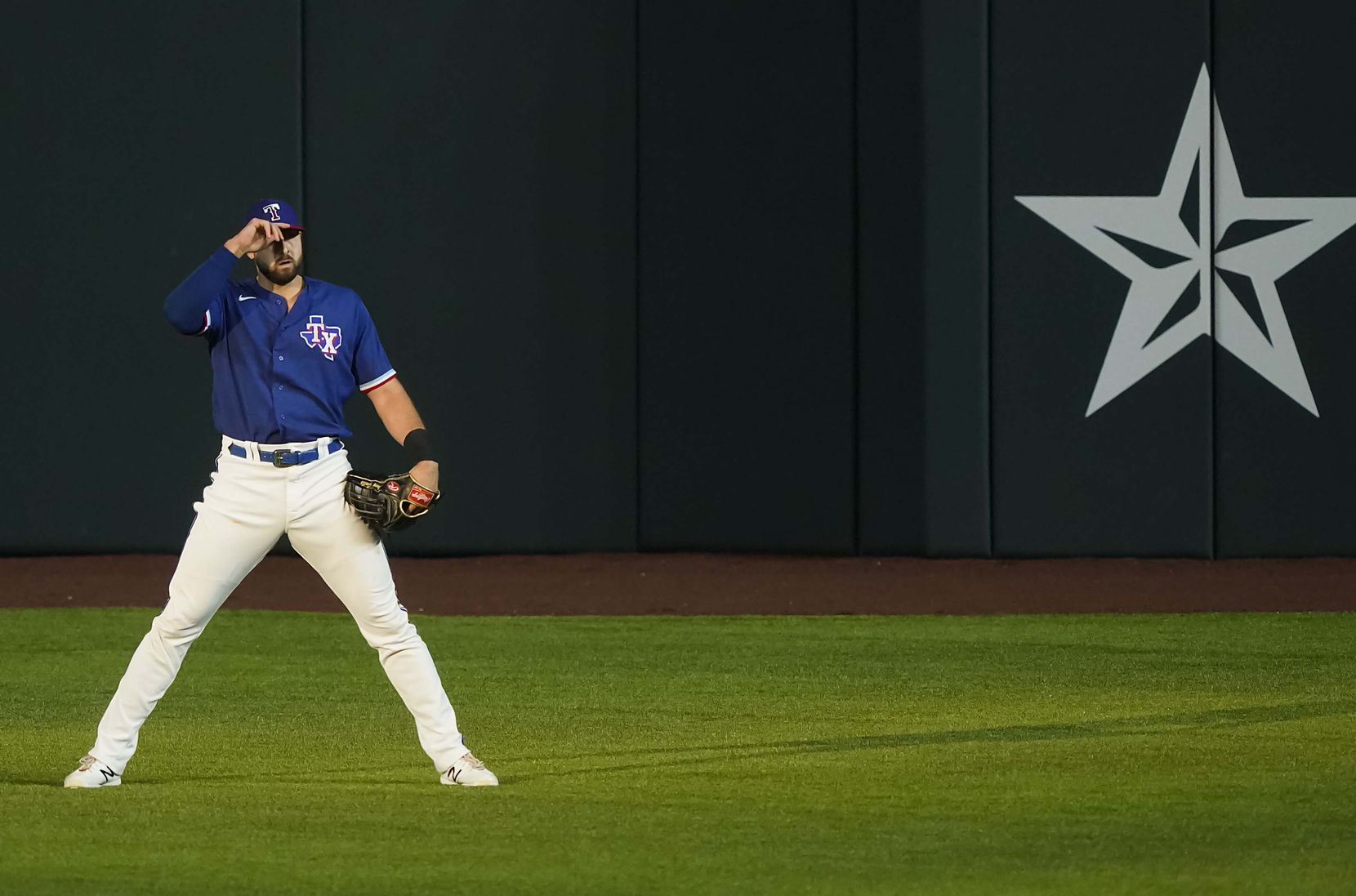 Texas Rangers outfielder Joey Gallo adjusts his cap as sunlight filters over right field during the second inning of an exhibition game against the Colorado Rockies at Globe Life Field on Wednesday, July 22, 2020.