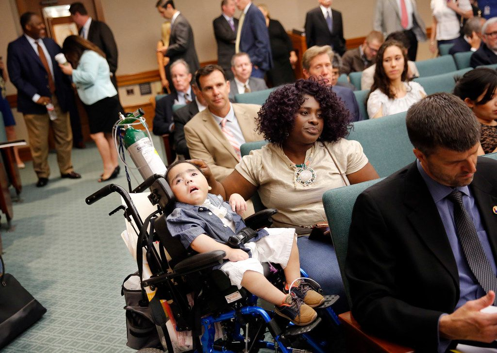 Linda Badawo of Mesquite waited with her 3-year-old son, D'ashon Morris, for testimony to continue after she testified Wednesday before the Texas House Committee on Human Services.